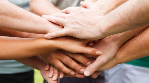 Alzheimer Care staff hands rally
